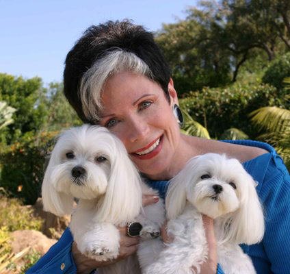 Dog Care Expert Jan Rasmusen with her Maltese, Jiggy and Chiclet
